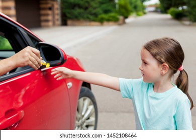 Stranger in the car offers candy to the child. Kids in danger. Children safety protection kidnapping concept.
