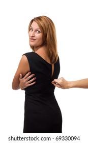 Strangers hand unzipping dress