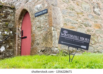 STRANGFORD, NORTHERN IRELAND - May 3, 2015: Winterfell Tours sign at Castle Ward, a famous filming for fantasy TV show Game of Thrones