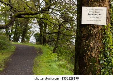 STRANGFORD, NORTHERN IRELAND - May 3, 2015: A Game of Thrones cycle trail sign at Castle Ward, a famous filming location for fantasy TV show Game of Thrones