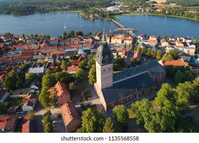 Strangnas, Sweden - July 16, 2018: Aerial view of the scandinavian brick gothic Strangnas cathedral surronded by the town.