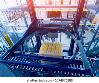 Strapping machine for packaging line. Modern machine for packaging line in factory. Technology and industrial concept. Background