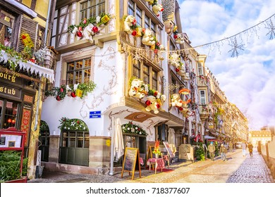 Strasbourg, Alsace, France - December 12, 2016: Streets and facades of houses, traditionally decorated with toys and teddy bears for Christmas in medieval city of Strasbourg - the capital of Christmas
