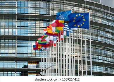 Strasbourg, Bas-Rhin / France - 14. December, 2019: close up view of the European Union Parlament building and flags of all member states in Strasbourg