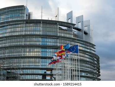 Strasbourg, Bas-Rhin / France - 14. December, 2019: horizontal view of the European Union Parlament building and flags of all member states in Strasbourg