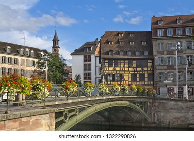Strasbourg cityscape with Cathedral spire, canal and bridge