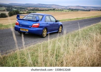 Strasbourg, FRANCE - 06 JULY 2018: Subaru STI 2003 type UK driving in the backcountry.