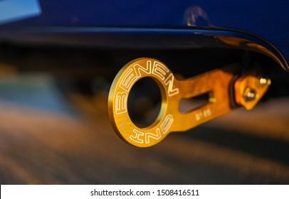 Strasbourg, FRANCE - 06 JULY 2018: Subaru STI 2003. Gold racing Benen tow hook at sunset.