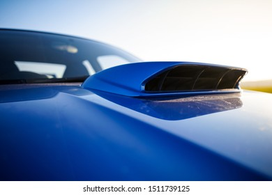 Strasbourg, FRANCE - 06 JULY 2018: Subaru STI 2003 type UK driving in the backcountry. Hood scoop cooling engine.