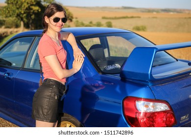 Strasbourg, FRANCE - 06 JULY 2018: Subaru STI 2003 type UK driving in the backcountry. Girl and car.