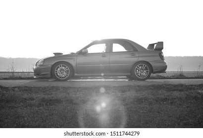 Strasbourg, FRANCE - 06 JULY 2018: Subaru STI 2003 type UK driving in the backcountry. Side view.