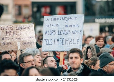 STRASBOURG, FRANCE - 11 JAN, 2015:  People hold placards reading 'Je suis Charlie' during a unity rally (Marche Republicaine) where some 50000 took part in tribute three-day killing spree in Paris