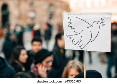 STRASBOURG, FRANCE - 11 JAN, 2015:  People hold placards with a peace pigeon during a unity rally (Marche Republicaine) where some 50000 took part in tribute three-day killing spree in Paris