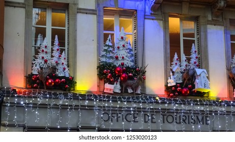 Strasbourg / France - 12 04 2018: christmas decoration at window of Tourism office in Strasbourg, city called Capital of Christmas, Alsace, Europe (translation: Office de Tourisme = tourist office)