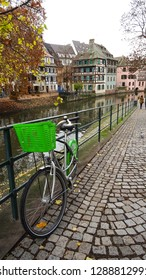 Strasbourg / France - 12 04 2018 : canal of river Ill and street with parked bike in La Petite France (Little France) charming and historic quartier in Strasbourg city, Alsace region, France, Europe