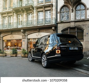 STRASBOURG, FRANCE - 13 MAR, 2018: New Range Rover Land Rover Vogue, the luxury British SUV parked in central French street near butcher shop Porcus Place du Temple Neuf
