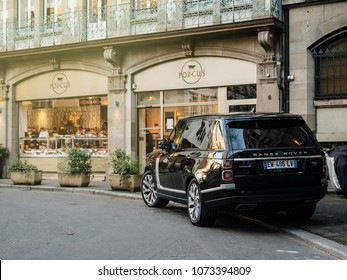 STRASBOURG, FRANCE - 13 MAR, 2018: New Range Rover Land Rover Vogue, the luxury British SUV parked in central French street near butcher shop Porcus (Place du Temple Neuf)