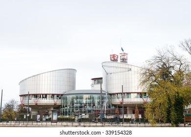 STRASBOURG, FRANCE - 14 Nov 2015: European Union Flag flies at half-mast in front of the European Court of human Rights following an terrorist attack in Paris