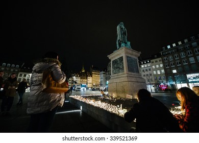 STRASBOURG, FRANCE - 14 NOV 2015: People attend a vigil and light candles in the center of Strasbourg under Gerneral Kleber statue for the victims of the November 13 attacks in Paris