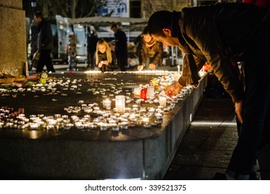 STRASBOURG, FRANCE - 14 NOV 2015: People attend a vigil and light candles in the center of Strasbourg for the victims of the November 13 attacks in Paris that killed at least 128 people