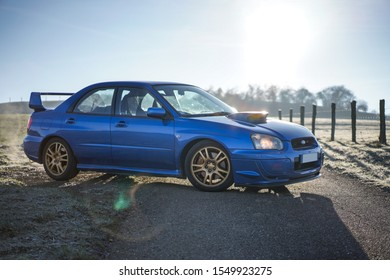 Strasbourg, FRANCE - 16 march 2018: Subaru STI 2003 type UK driving in the backcountry during frozen morning.