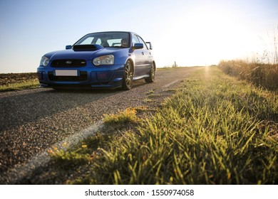 Strasbourg, FRANCE - 16 march 2018: Subaru STI 2003 type UK driving in the backcountry during sunset.