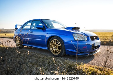 Strasbourg, FRANCE - 16 march 2018: Subaru STI 2003 type UK driving in the backcountry during frozen morning and mist.