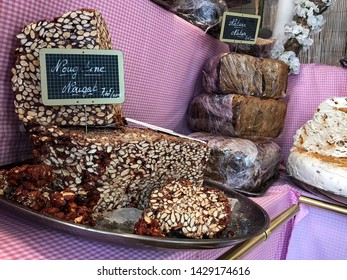 Strasbourg, France - 17 April 2019: Street nougat shop in the centre. Display stand with nougat.