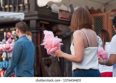 Strasbourg - France - 20 April 2019 -  people eating candyfloss in the street