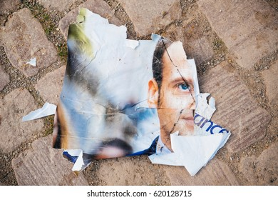 STRASBOURG, FRANCE - APR 12, 2017: Destroyed broken  official campaign posters of Emmanuel Macron, political party leader ones of the eleven candidates running in the 2017 French presidential election