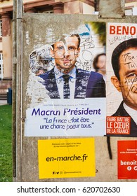 STRASBOURG, FRANCE - APR 12, 2017: Official campaign posters of Emmanuel Macron, political party leader of En marche ! (EM !), ones of the eleven candidates in the 2017 French presidential election