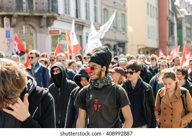 STRASBOURG, FRANCE - APR 20, 2016: Man wearing clown nose as hundreds of people demonstrate as part of nationwide day of protest against proposed labor reforms by Socialist Government