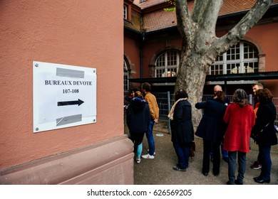 STRASBOURG, FRANCE - APR 23, 2017: Bureaux de Vote Voting section sign and people silhouettes queue to vote in the first round of the French presidential election in the city of Strasbourg, France