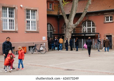 STRASBOURG, FRANCE - APR 23, 2017: People queue to vote in the first round of the French presidential election in the city of Strasbourg, France, Alsace