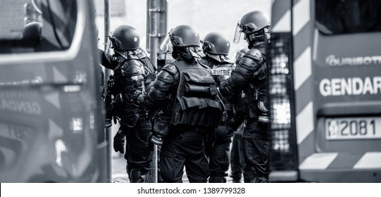 Strasbourg, France - Apr 28, 2019: Rear view of French police officers gendarmes near police vans near Council of Europe during altercations protest of yellow vests gilets jaunes black and white