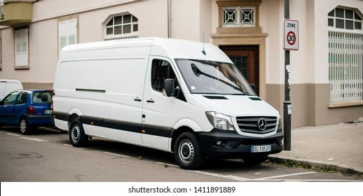 Strasbourg, France - Apr 5, 2017: White Mercedes-Benz Sprinter van parked on French street  - delivery van