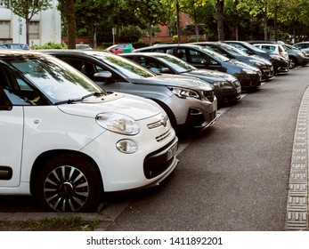 Strasbourg, France - Apr 8, 2017: Rows of multiple cars parked in residential neighborhood in French city