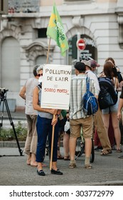 STRASBOURG, FRANCE - AUG 6, 2015: People wearing air masks protesting against air pollution in Strasbourg, Alsace, France - old woman holding placard: pollution kills 50000 yearly