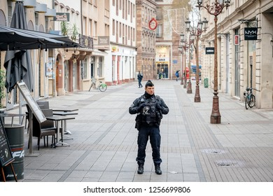 STRASBOURG, FRANCE - DEC 11, 2018: French Police officers securing Rue du Vieux Marche aux Grains in front of a crime scene after an attack in the Strasbourg Christmas market area