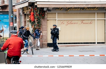 STRASBOURG, FRANCE - DEC 11, 2018: French Police officers securing Rue du Saumon zone of a crime scene after an terrorist attack in the Strasbourg Christmas market area