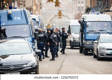 STRASBOURG, FRANCE - DEC 11, 2018: Police French vans and Police officers securing Place Gutenberg square near crime scene after an attack in the Strasbourg Christmas market area