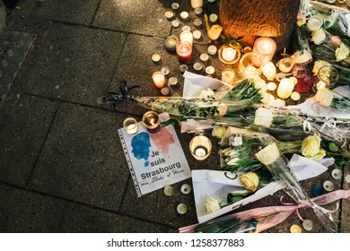 STRASBOURG, FRANCE - DEC 13, 2018: Je suis Strasbourg message Rue des Orfevres to attend a vigil with multiple light candles flowers and messages for the victims of terrorist Cherif Chekatt at