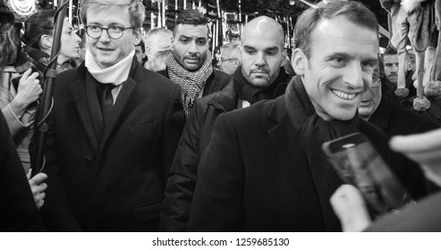 STRASBOURG, FRANCE - DEC 14, 2018: Smiling French President Emmanuel Macron shakes hands with members of a crowd at Christmas Market after paying tribute for victims of terrorist attack on 11 December