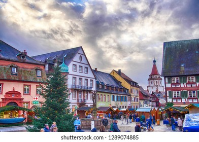 STRASBOURG, FRANCE - DEC 20, 2018 - Half timbered houses frame the Christmas market,Strasbourg, France