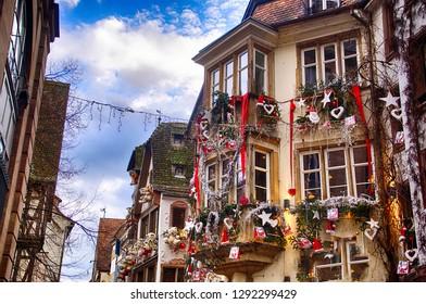 STRASBOURG, FRANCE - DEC 20, 2018 - Decorations on the buildings along street in Christmas market,Strasbourg, France