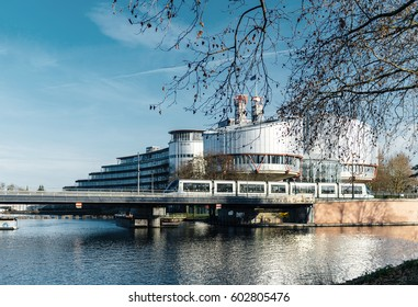STRASBOURG, FRANCE - DEC 25, 2015: Large building of the European Court of Human Rights building in Strasbourg, France on a warm winter day and Ill river. ECHR is a international court