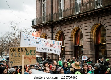 STRASBOURG, FRANCE - DEC 8, 2018: Elevated view of large crowd of people marching in Central Strasbourg at the nationwide protest Marche Pour Le Climat