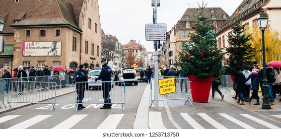 STRASBOURG, FRANCE - DEC 8, 2018: Police surveilling the entrance to Strasbourg Christmas Market in Strasbourg during winter holiday - city center surveillance