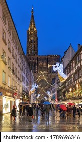 STRASBOURG, FRANCE - DECEMBER 15, 2019: Rue Merciere street with Christmas illumination, leading to Strasbourg Cathedral. Strasbourg has been holding Christmas market around its cathedral since 1570.