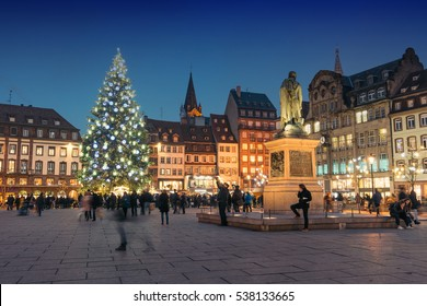 STRASBOURG, FRANCE - DECEMBER 16, 2016: Christmas tree with Christmas market at Kleber Square at night.